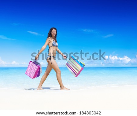 Woman with shopping bags on the beach.  - stock photo