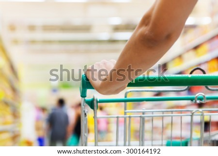 Woman with shopping cart - stock photo