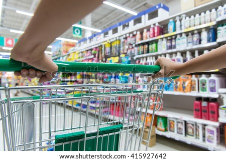 Woman with shopping cart, close up - stock photo