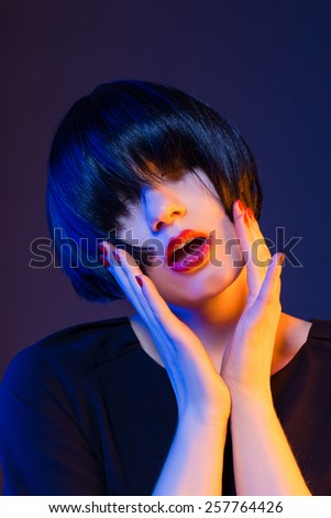 woman with short hair and dark hair. red lips - stock photo