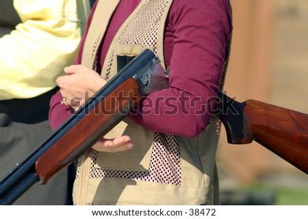 woman with shotgun on trap range - stock photo