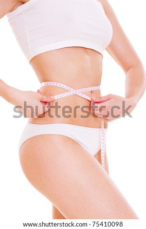 woman with slender waist over white background - stock photo