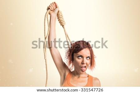 Woman with slipknot around her neck - stock photo