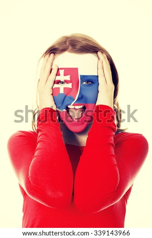 Woman with Slovakia flag painted on face. - stock photo