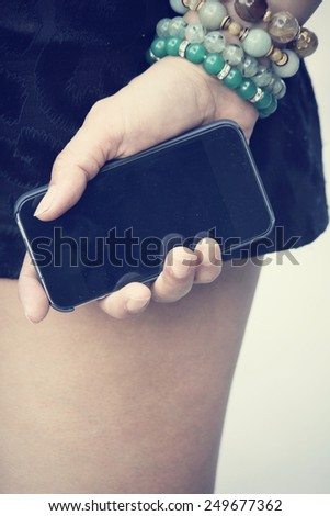 Woman with smart phone - stock photo