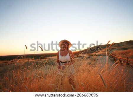woman with smile during sunset or sunrise with sunlight overlay
