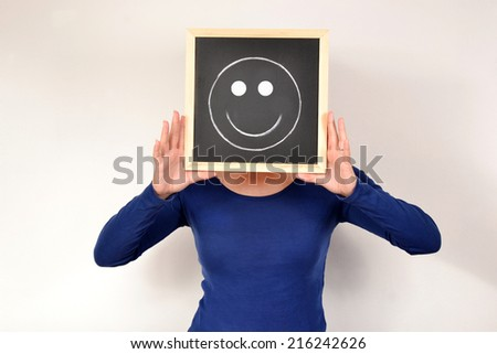 Woman with smiling face in blackboard