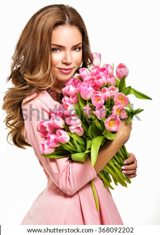 Woman with Spring Flower bouquet. Happy surprised model woman smelling flowers. Mother's Day. Springtime