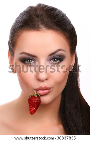 woman with strawberry in mouth - stock photo