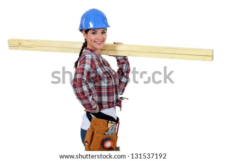 Woman with strips of wood on her shoulder - stock photo