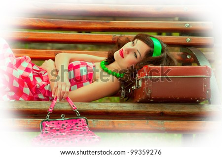 Woman with suitcases. Retro style. - stock photo