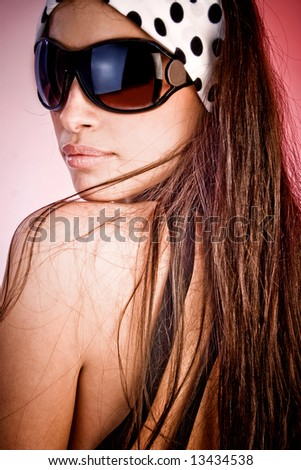 woman with sunglasses portrait, studio - stock photo