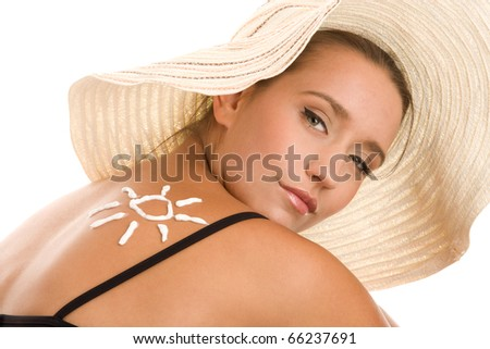 Woman with suntan lotion - stock photo