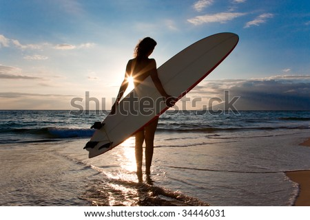 woman with surfboard and shinning sun light - stock photo