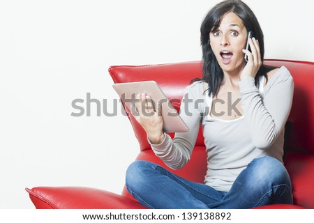 Woman with surprised expression while receiving a phone call. Copy space. Horizontal. Black hair middle age woman. - stock photo