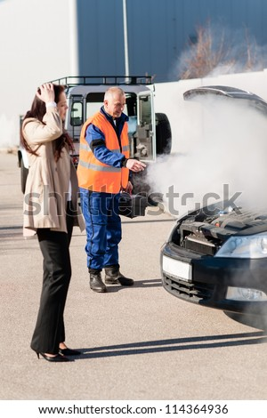 Woman with technician help smoking engine car breakdown trouble accident - stock photo