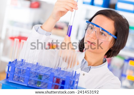 Woman with test tube - stock photo