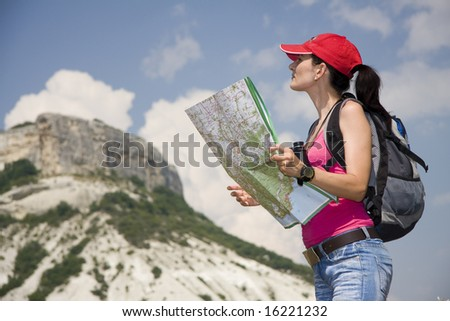 woman with the binoculars in the mountains - stock photo