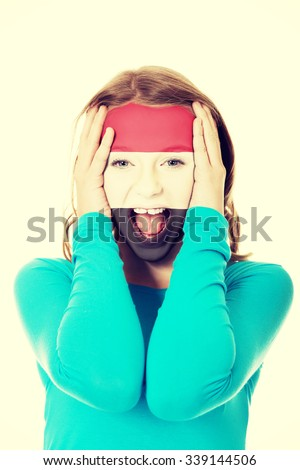 Woman with the flag of Egypt painted on face. - stock photo