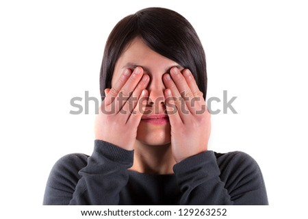 Woman with the see no evil gesture - stock photo