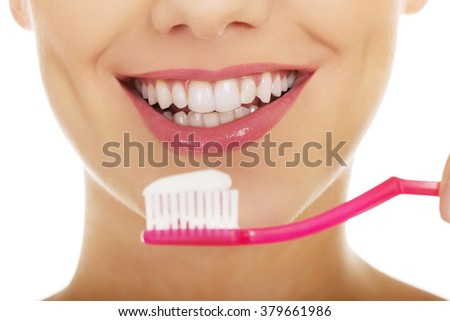 Woman with toothbrush. - stock photo