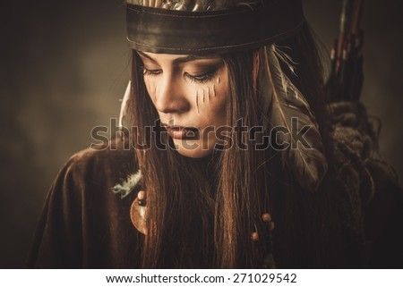 Woman with traditional indian headdress and face paint  - stock photo