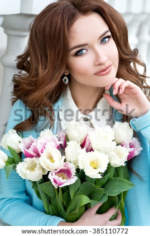 Woman with tulips bouquet