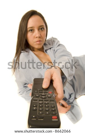 Woman with TV remote control - stock photo