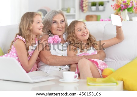 woman with tweenie   girls doing selfie - stock photo