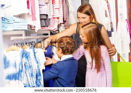 Woman with two children shopping together - stock photo