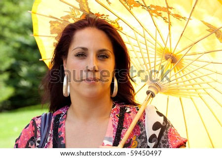 Woman with Umbrella - stock photo