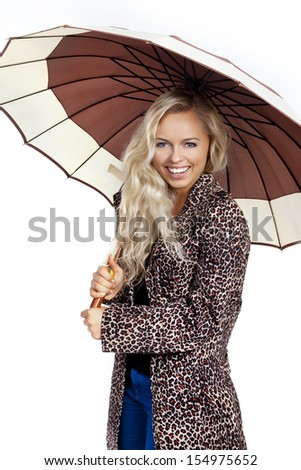 Woman with umbrella smiling - stock photo
