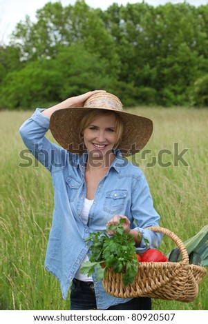 woman with vegetables basket - stock photo