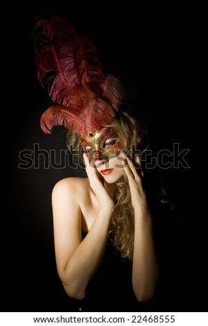 woman with Venetian mask and red feathers - stock photo