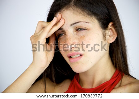 Woman with very strong headache suffering - stock photo