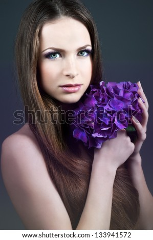 Woman with violet flowers