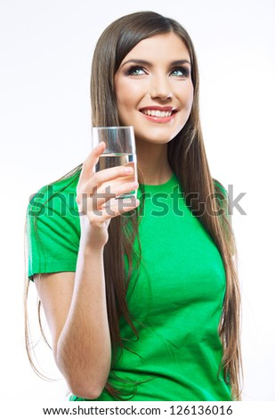 Woman with water glass standing against white background