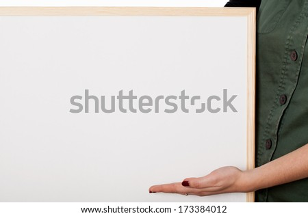 Woman with white board showing you space for your text - stock photo