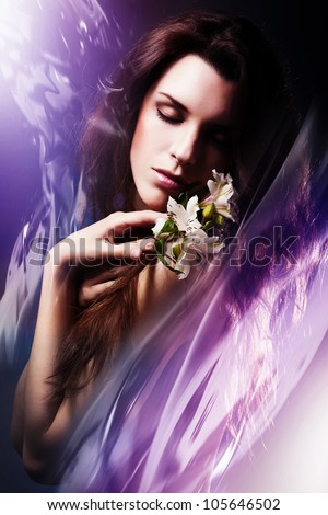woman with white flowers and water - stock photo