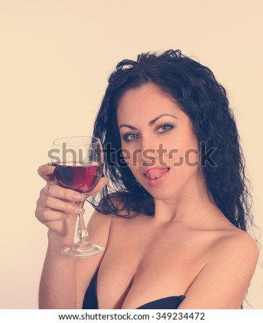 Woman with wineglass. Retro vintage style. - stock photo