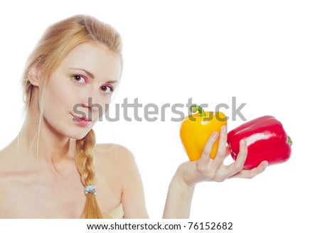 woman with yellow and red peppers isolated on white - stock photo