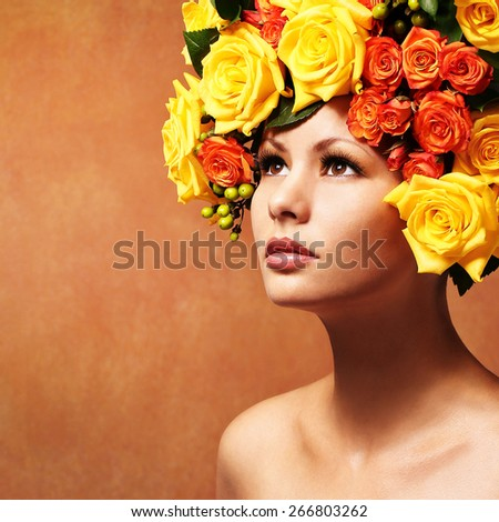 Woman with Yellow Roses. Model Girl with Flowers Hair. Fashion Beauty