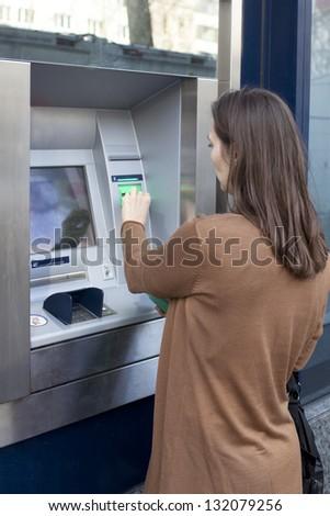 Woman withdraws money - stock photo