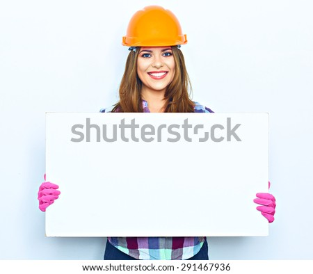 Woman worker builder hold big sign board against white background. Building helmet. Pink glow. - stock photo