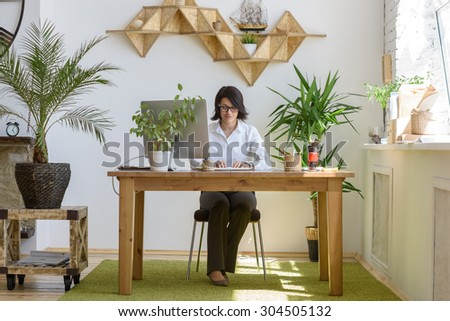 Woman working at modern office - stock photo