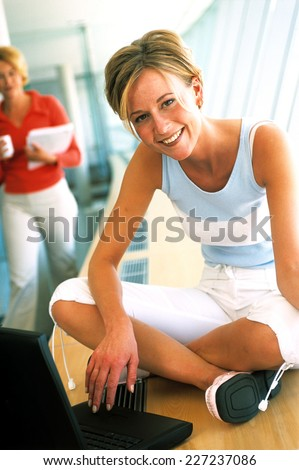 Woman working at the office in the windowframe. - stock photo