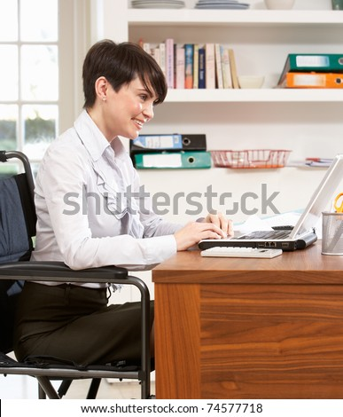 Woman Working From Home Using Laptop