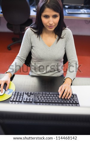 Woman working in computer class in college - stock photo