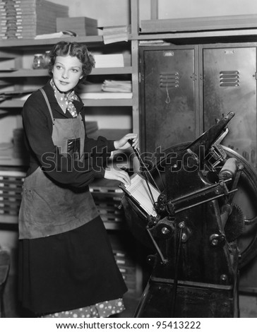 Woman working in print shop - stock photo