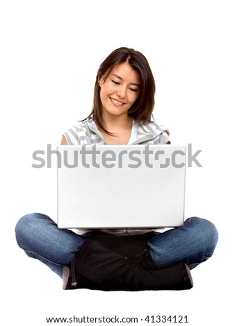 Woman working on a laptop isolated over a white background